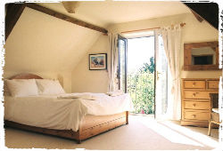 photo of a bedroom at Mazzard Farm cottages